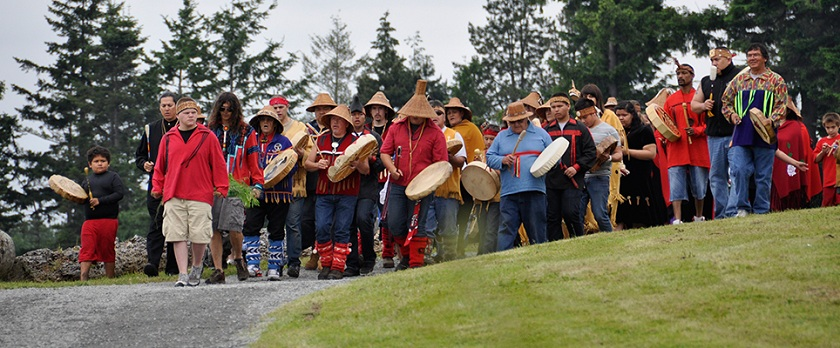 People greeting the canoes at Tulalip Bay