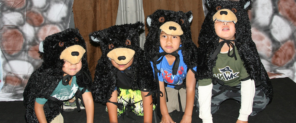 Children performing as black bears in a local production